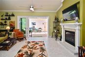 Living room with slider to lanai - Single Family Home for sale at 753 Guild Dr, Venice, FL 34285 - MLS Number is N6105757