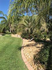 Beautifully landscaped yard - Single Family Home for sale at 19694 Cobblestone Cir, Venice, FL 34292 - MLS Number is N6109367