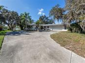 Front of house - Single Family Home for sale at 915 Bayshore Rd, Nokomis, FL 34275 - MLS Number is N6109471
