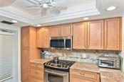 Kitchen - Condo for sale at 1150 Tarpon Center Dr #303, Venice, FL 34285 - MLS Number is N6110126