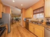 Foyer, kitchen - Villa for sale at 1244 Berkshire Cir, Venice, FL 34292 - MLS Number is N6110278