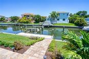 Paver steps leading to the dock with 12,000 lb Boat Lift - Single Family Home for sale at 510 Bowsprit Ln, Longboat Key, FL 34228 - MLS Number is N6110334