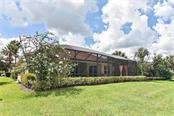 Rear exterior - Single Family Home for sale at 193 Medici Ter, North Venice, FL 34275 - MLS Number is N6110365