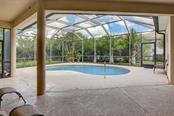 Lanai, pool - Single Family Home for sale at 1031 Scherer Way, Osprey, FL 34229 - MLS Number is N6111839