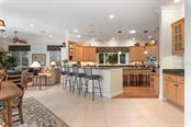 Kitchen, family room - Single Family Home for sale at 725 Eagle Point Dr, Venice, FL 34285 - MLS Number is N6111842