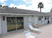 Clubhouse & Sunning deck by pool - Condo for sale at 1041 Capri Isles Blvd #121, Venice, FL 34292 - MLS Number is N6112042