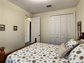 Bedroom 2 - Single Family Home for sale at 108 Maraviya Blvd, North Venice, FL 34275 - MLS Number is N6113946