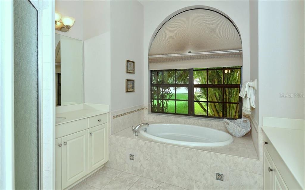 Master Bath with large soaking tub - Single Family Home for sale at 1141 Arbroid Dr, Englewood, FL 34223 - MLS Number is D6101353