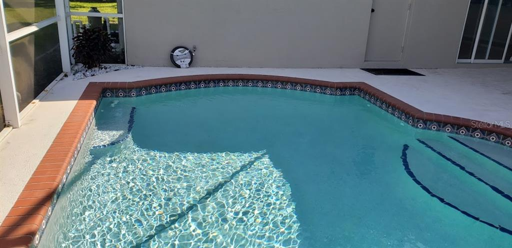Pool steps and seats - Single Family Home for sale at 4945 79th St E, Bradenton, FL 34203 - MLS Number is T3163646