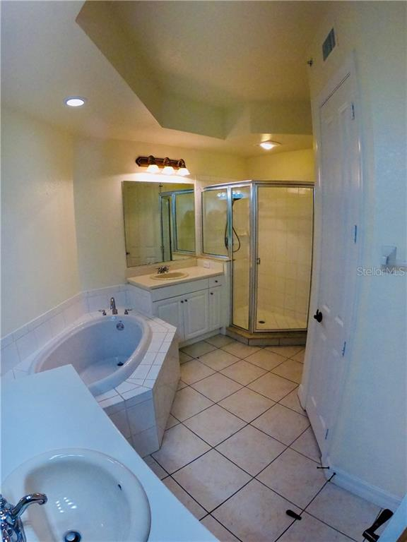 Master bath with two separate sinks, a huge tub, full walk in shower, linen closet and private commode. - Condo for sale at 98 Vivante Blvd #9828, Punta Gorda, FL 33950 - MLS Number is C7242665