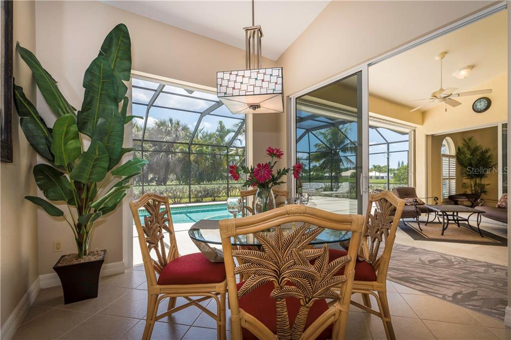 Enjoy breakfast or a casual meal overlooking the lanai and pool. - Single Family Home for sale at 931 Linkside Way, Punta Gorda, FL 33955 - MLS Number is C7400849