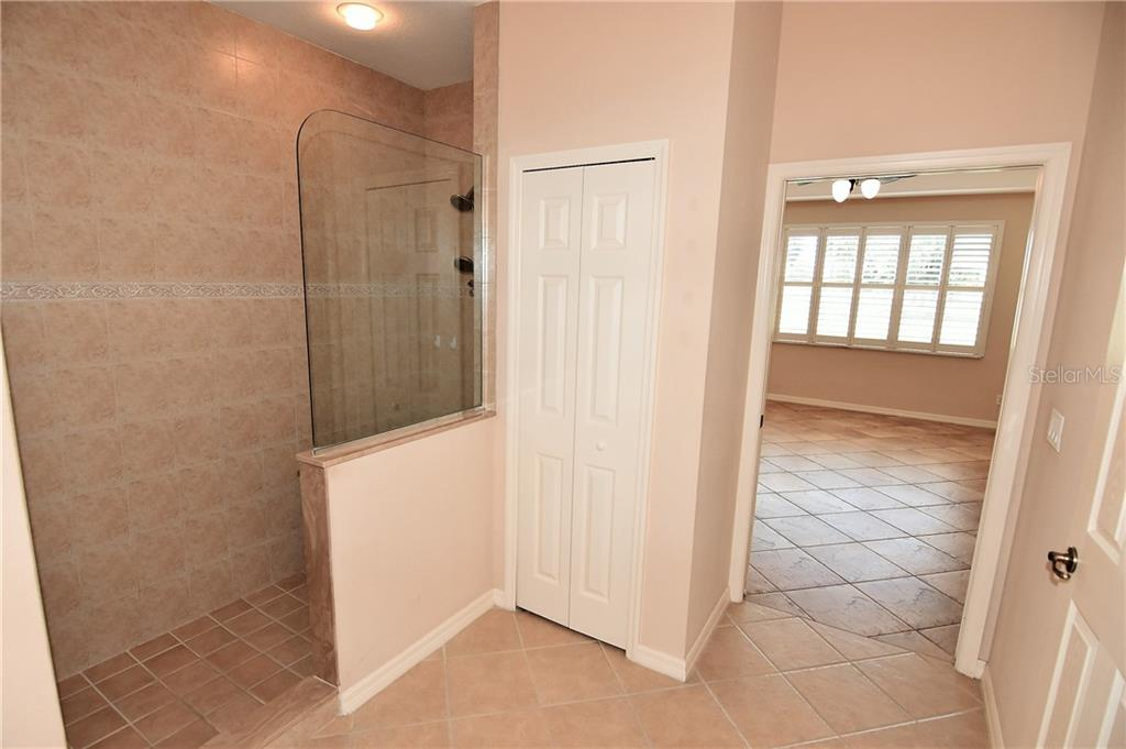 Master bath with Dual sinks, water closet, walk-in shower and large walk-in closet - Condo for sale at 3959 San Rocco Dr #212, Punta Gorda, FL 33950 - MLS Number is C7409637