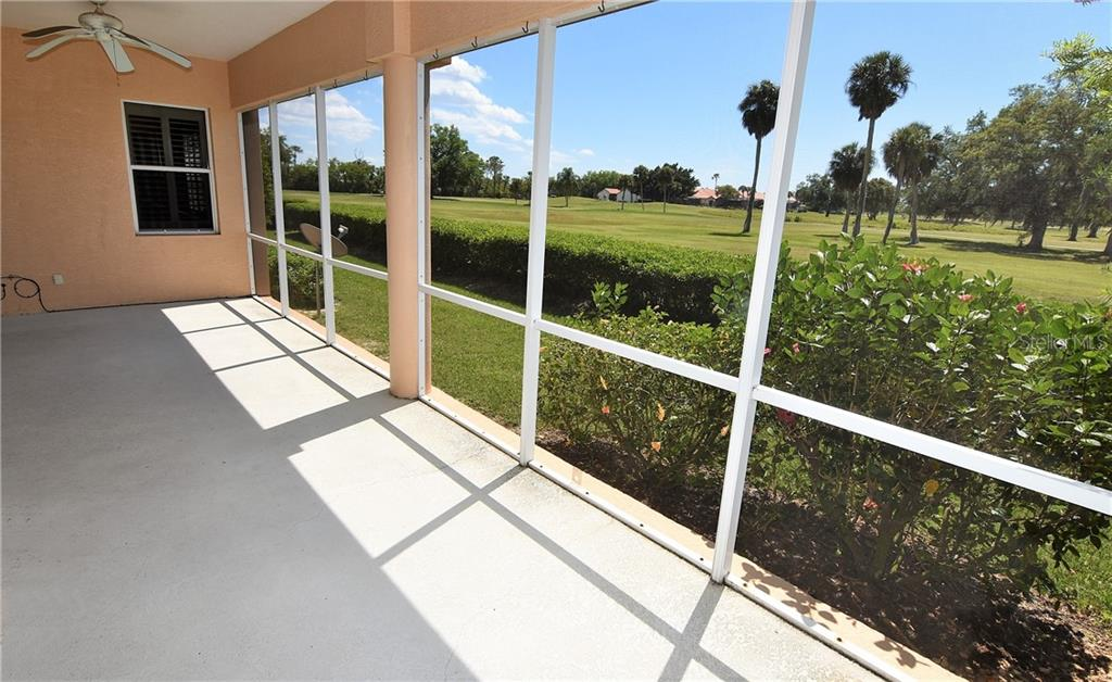 Large covered/screened lanai with long views of golf course and preserve area. - Condo for sale at 3959 San Rocco Dr #212, Punta Gorda, FL 33950 - MLS Number is C7409637