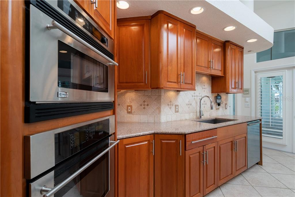 Beautiful Cherry Wood cabinets, Silestone counters and tumbled marble back splash. - Single Family Home for sale at 1309 Casey Key Dr, Punta Gorda, FL 33950 - MLS Number is C7413790