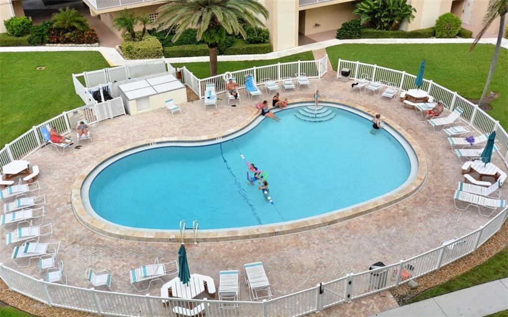 Community swimming pool and sun deck - Condo for sale at 5830 Midnight Pass Rd #504, Sarasota, FL 34242 - MLS Number is A4166623