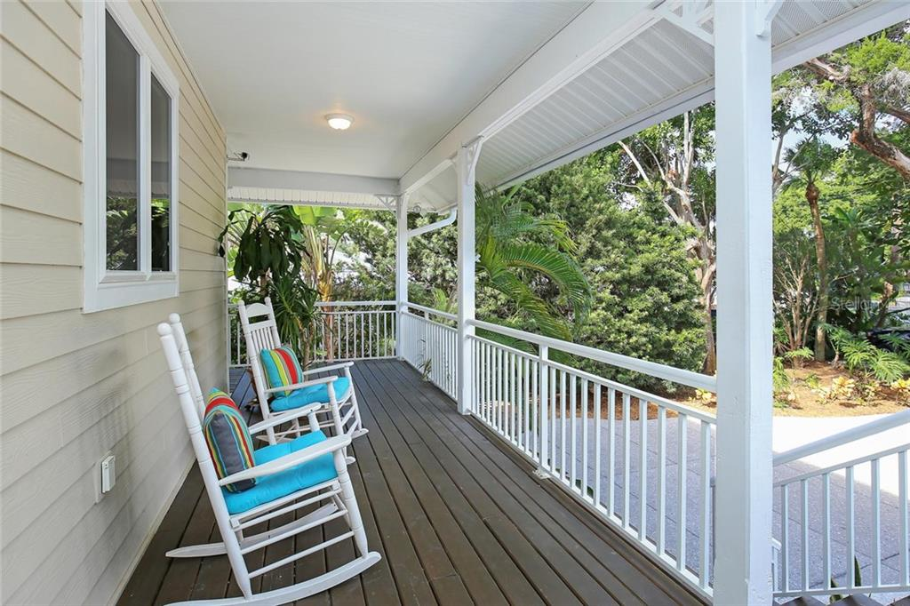 Wrap Around Deck from Front Door and to the Side of the House with private entrance to Guest Bedroom. - Single Family Home for sale at 722 Siesta Dr, Sarasota, FL 34242 - MLS Number is A4169257