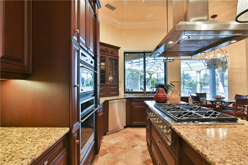 Consistency of flooring all throughout this home offers a flowing design.  Cook for two or twenty in this fabulous kitchen that has views to the enormous lanai and the family room. - Single Family Home for sale at 8365 Catamaran Cir, Lakewood Ranch, FL 34202 - MLS Number is A4187448