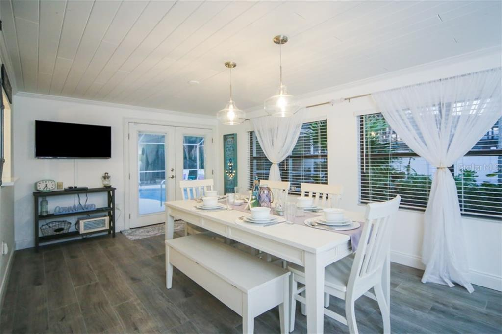 Large dining area with sliding barn door - Single Family Home for sale at 213 70th St, Holmes Beach, FL 34217 - MLS Number is A4202171