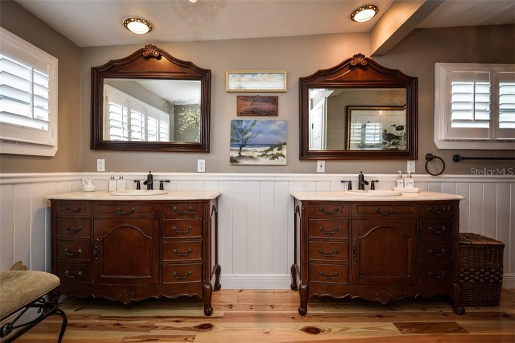 Master bath with double vanities, heart pine floors, plantation shutters and recessed lighting. - Single Family Home for sale at 306 Gulf Blvd, Anna Maria, FL 34216 - MLS Number is A4206962