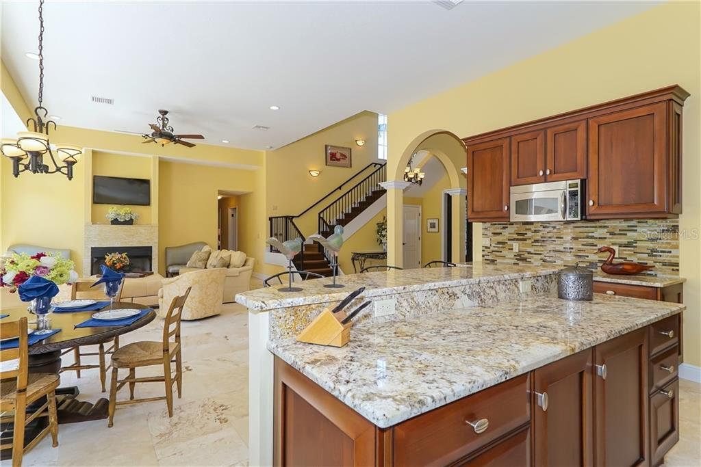Open concept kitchen makes entertaining a breeze - Single Family Home for sale at 1179 Morningside Pl, Sarasota, FL 34236 - MLS Number is A4209174