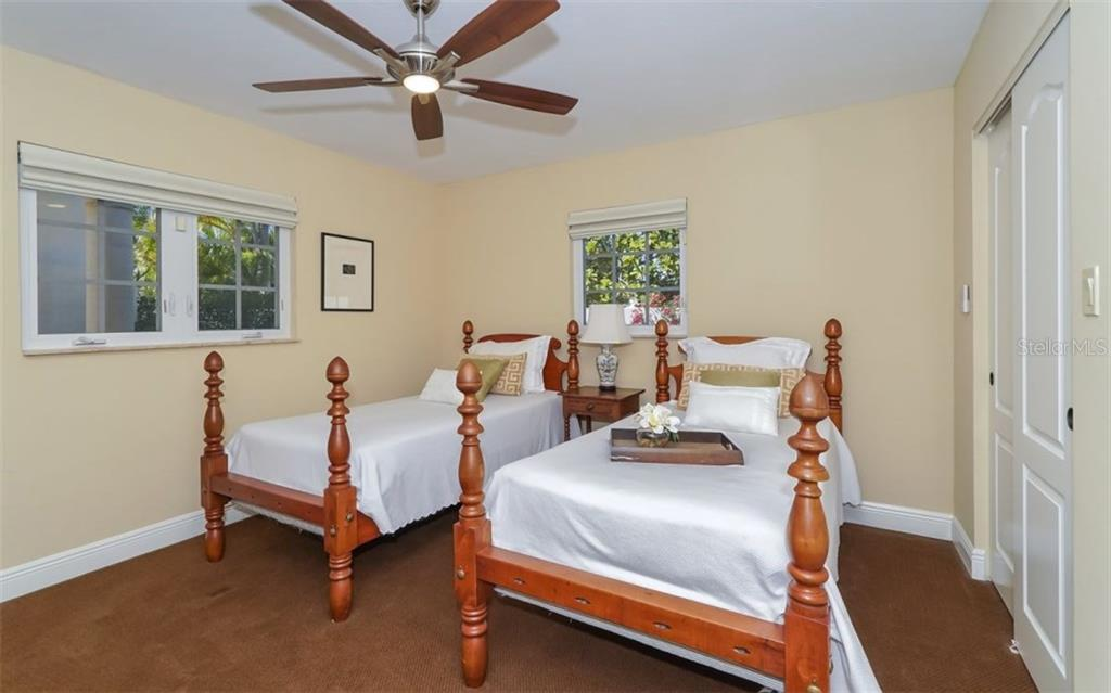 Downstairs Master bedroom - Single Family Home for sale at 1179 Morningside Pl, Sarasota, FL 34236 - MLS Number is A4209174