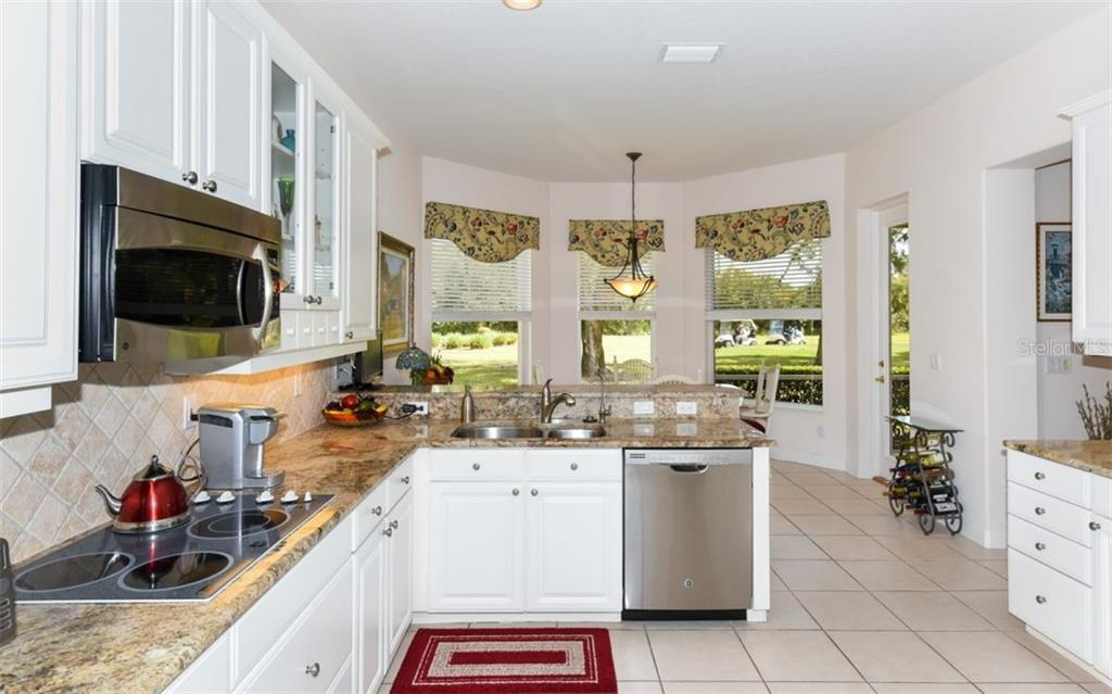 Large light and bright kitchen with a golf course view! - Single Family Home for sale at 8473 Eagle Preserve Way, Sarasota, FL 34241 - MLS Number is A4425945
