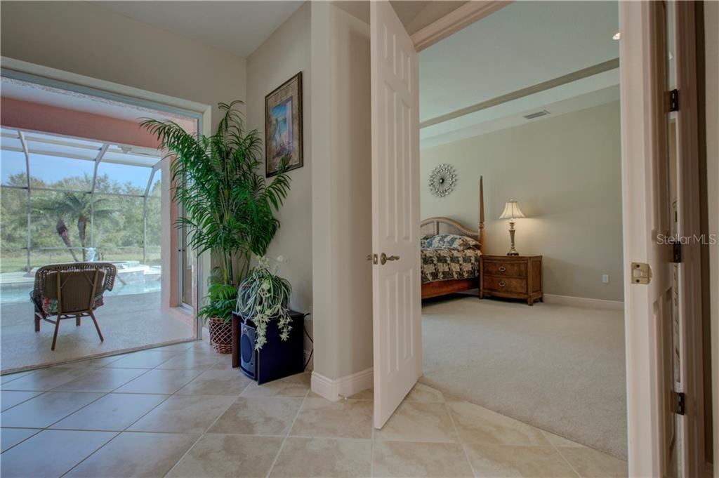 Double-door entrance to the large master bedroom. - Single Family Home for sale at 15109 17th Ave E, Bradenton, FL 34212 - MLS Number is A4425963