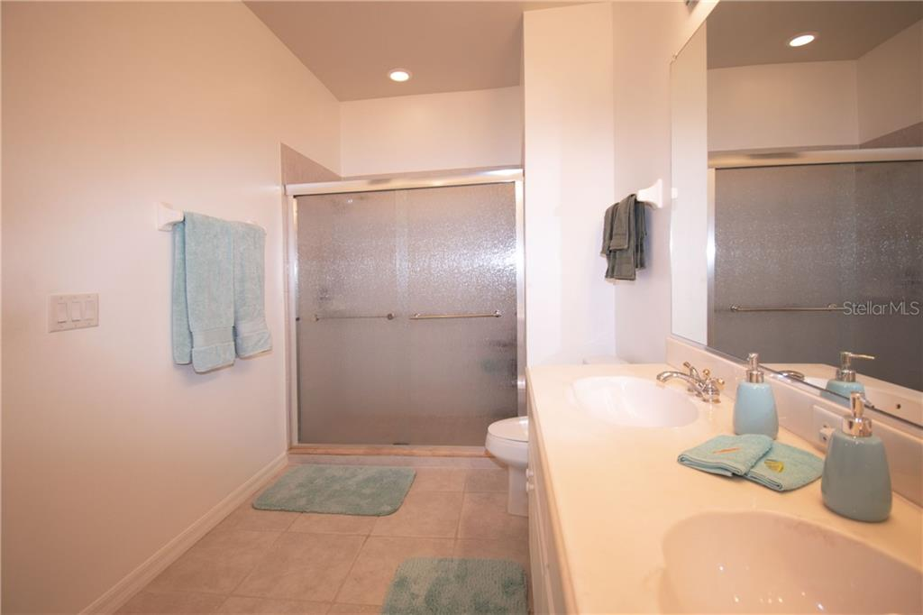Large Master Bath with dual sinks and walk-in-shower with new glass doors - Villa for sale at 1808 Batello Dr, Venice, FL 34292 - MLS Number is A4426491