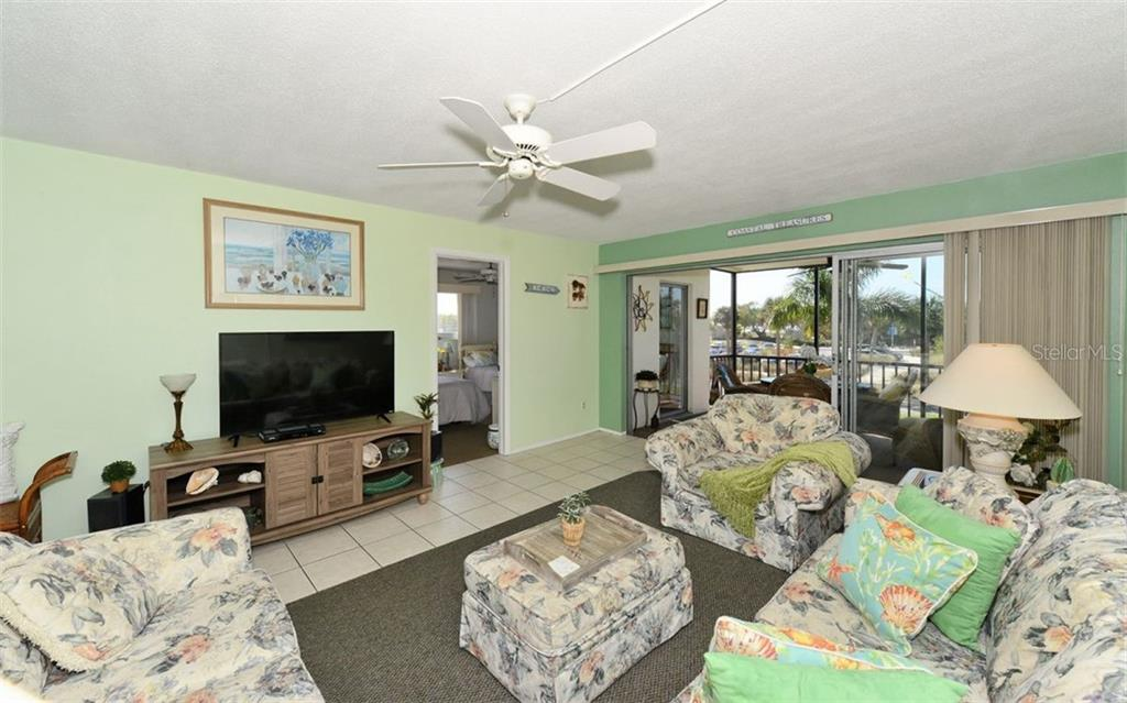 Living Room. - Condo for sale at 797 Beach Rd #215, Sarasota, FL 34242 - MLS Number is A4430524