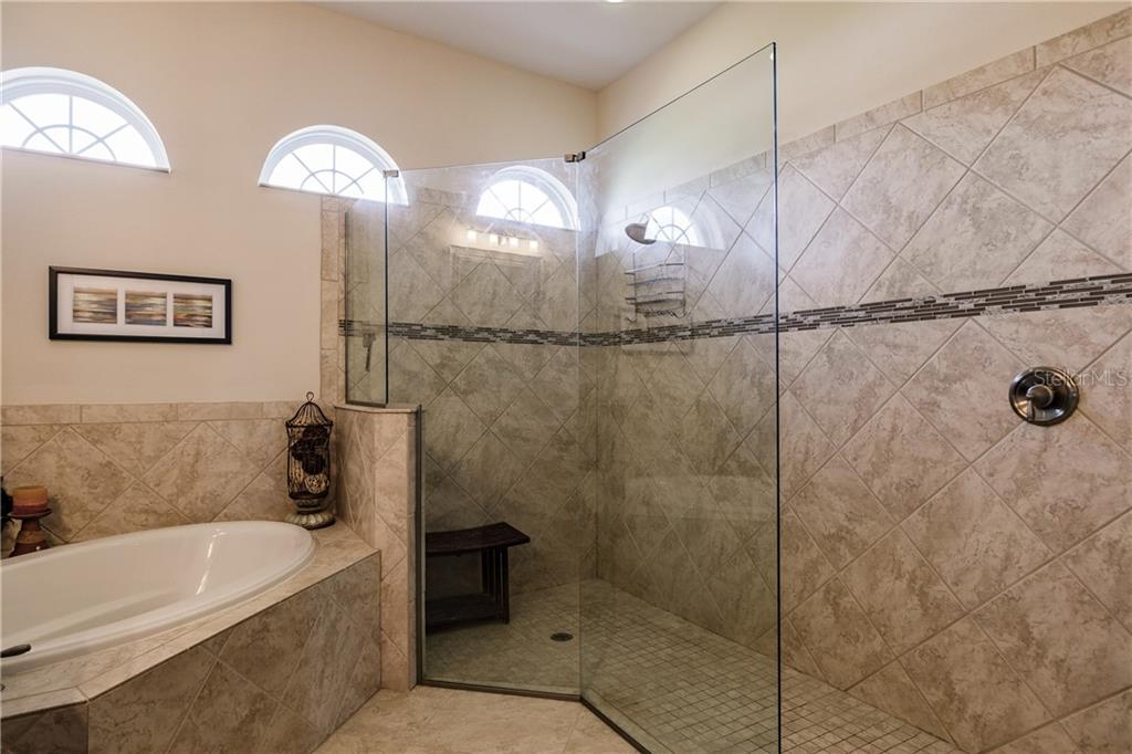 Master bathroom shower and tub. - Single Family Home for sale at 17006 1st Dr E, Bradenton, FL 34212 - MLS Number is A4432830