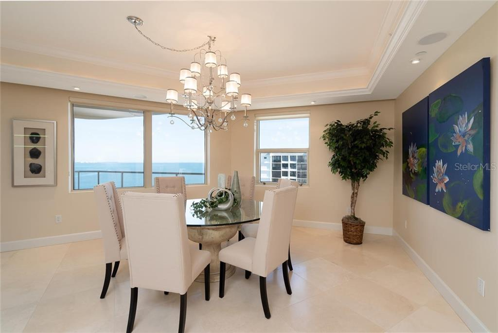 Separate formal dining area with more water vistas of the Sarasota Bay and bustling downtown Sarasota! - Condo for sale at 128 Golden Gate Pt #902a, Sarasota, FL 34236 - MLS Number is A4433296