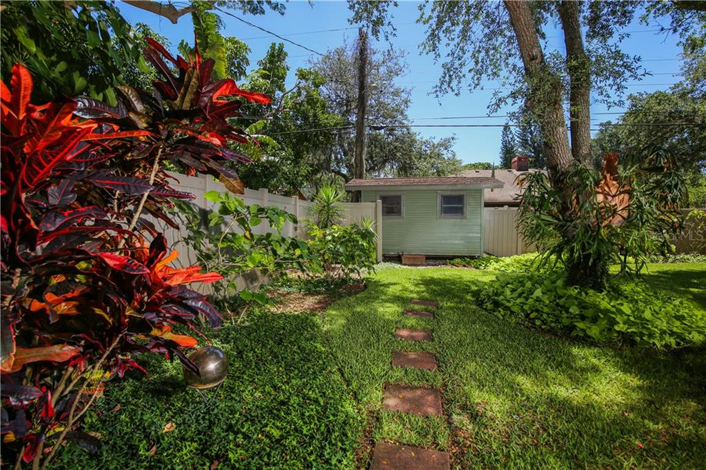 Beautiful tropical landscaping in backyard - Single Family Home for sale at 7611 Alhambra Dr, Bradenton, FL 34209 - MLS Number is A4434753