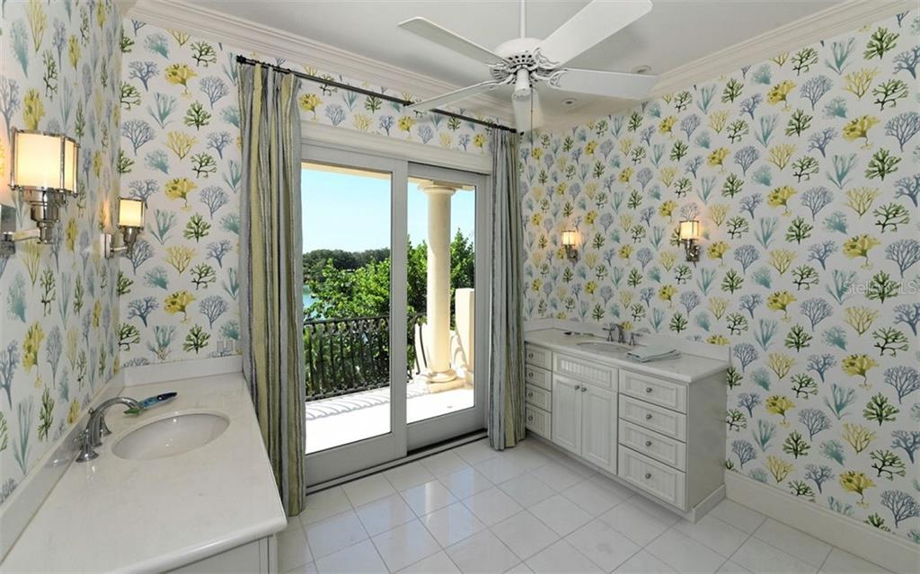 Second floor additional master suite bathroom - Single Family Home for sale at 65 Lighthouse Point Dr, Longboat Key, FL 34228 - MLS Number is A4438181