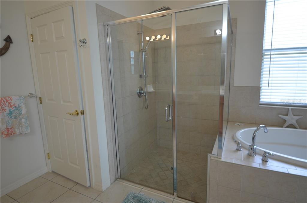 Very large master bathroom oversized shower, nice garden tub all tiled floors. - Single Family Home for sale at 3632 Summerwind Cir, Bradenton, FL 34209 - MLS Number is A4438762