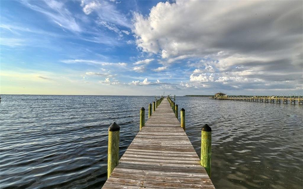 Boat dock with lift with water & power.  Water is 11 feet during low tide - Single Family Home for sale at 2316 Nw 85th St Nw, Bradenton, FL 34209 - MLS Number is A4445702