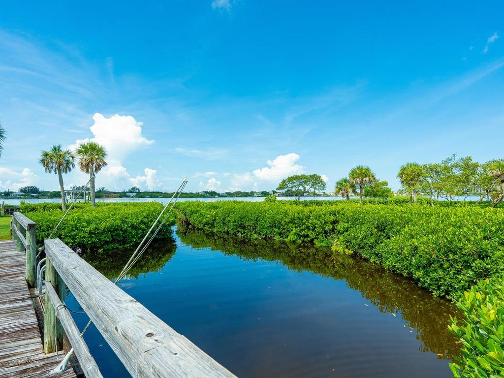 Private inlet with walkway - Single Family Home for sale at 1716 Bayshore Dr, Englewood, FL 34223 - MLS Number is A4445961