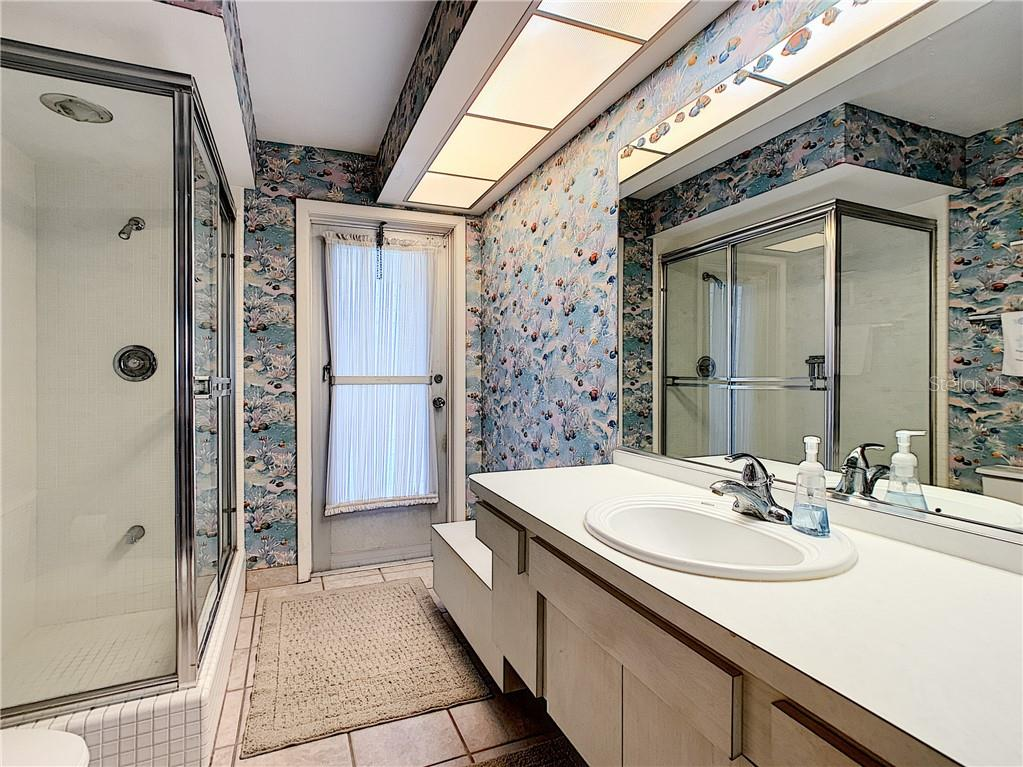 3rd full bathroom leading to pool. - Single Family Home for sale at 7006 18th Ave W, Bradenton, FL 34209 - MLS Number is A4450658