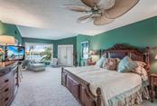 Master bedroom with en suite bath & views of ICW - Single Family Home for sale at 1253 Riegels Landing Dr, Sarasota, FL 34242 - MLS Number is A4203768