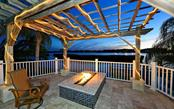 Elegantly simple with breath taking views!  Winter evenings are very enjoyable with the open fire pit - Single Family Home for sale at 5824 Tidewood Ave, Sarasota, FL 34231 - MLS Number is A4205461