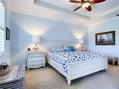 Master bedroom with tray ceilings. - Condo for sale at 9453 Discovery Ter #201c, Bradenton, FL 34212 - MLS Number is A4423314