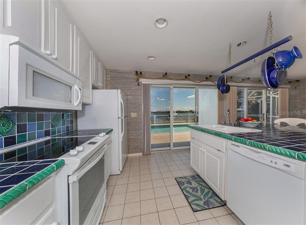 Kitchen with pool and bay views - Single Family Home for sale at 3509 Casey Key Rd, Nokomis, FL 34275 - MLS Number is N5915098