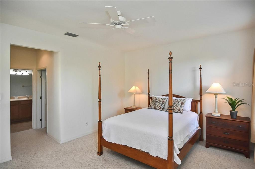 Master bedroom to master bath - Villa for sale at 11108 Batello Dr, Venice, FL 34292 - MLS Number is N6104651