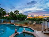 Sunset view from pool - Single Family Home for sale at 743 Eagle Point Dr, Venice, FL 34285 - MLS Number is N6101092